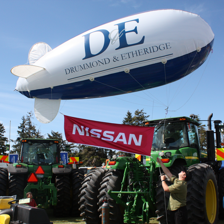 JFM Marketing + Design | Drummond & Etheridge D&E Blimp Signage